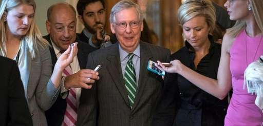 Senate Majority leader Mitch McConnell leaves the chamber