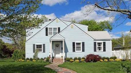 This Brightwaters Colonial is listed for $475,000.