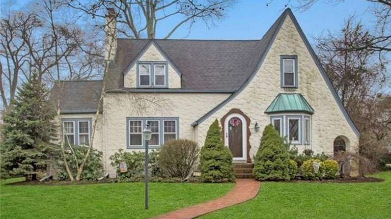 This Brightwaters Tudor is listed for $749,999.