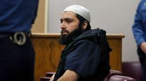 Ahmad Khan Rahimi sits in court in Elizabeth,