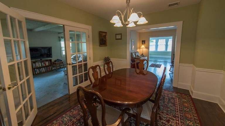 The dining room has French doors.
