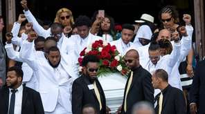 Pallbearers carry the casket of Philando Castile back