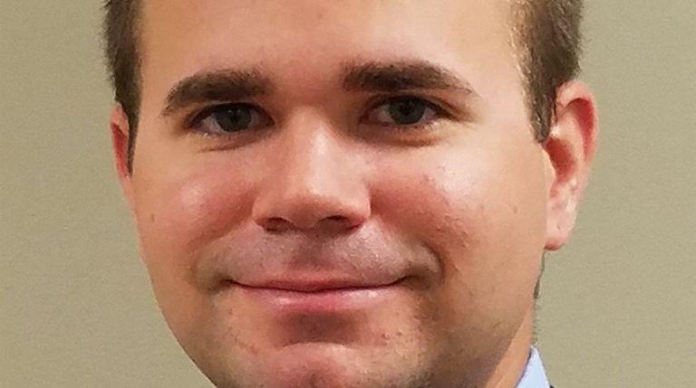 Glenn Rice, of Massapequa Park, has been promoted