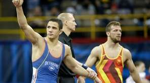 Aaron Pico, left, reacts after beating Reece Humphrey,