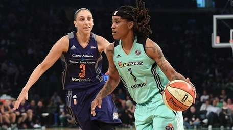 New York Liberty guard Shavonte Zellous drives ahead