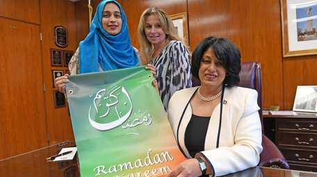 Hempstead Town Clerk Nasrin G. Ahmad, right, with