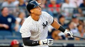 Aaron Judge of the Yankees follows through on a