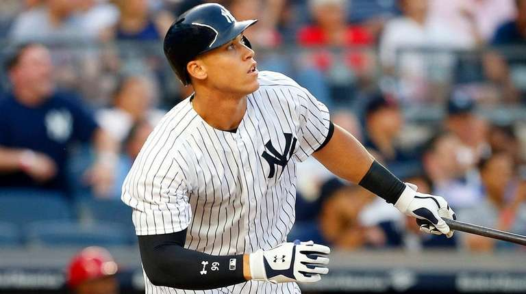 Aaron Judge of theYankees follows through on a