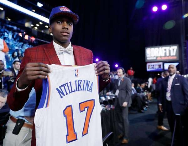 Frank Ntilikinaholds up his jersey after being picked