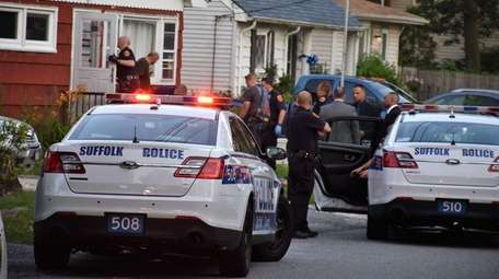 Suffolk County police respond to a shooting in