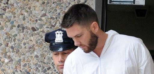 Christopher Bouchard, 27, of Mastic Beach, is led