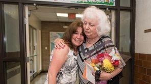 Bernadette Miller, right, hugs a former pupil on