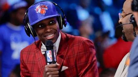 Frank Ntilikina does an interview after being selected