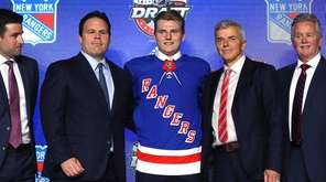 Lias Andersson poses after being selected seventh overall