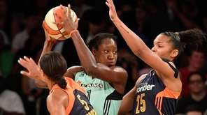 Tina Charles of the Liberty is closely defended