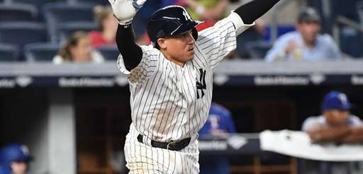New York Yankees shortstop Ronald Torreyes reacts after