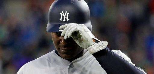 New York Yankees' Chris Carter walks off the