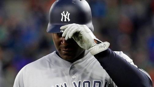 New York Yankees' Chris Carter walks off the