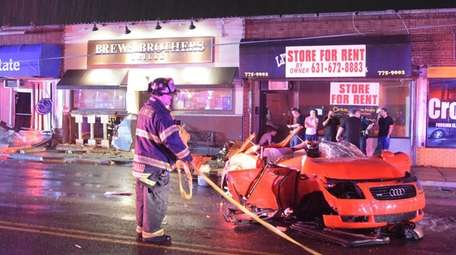 Firefighters at the scene after an alleged DWI