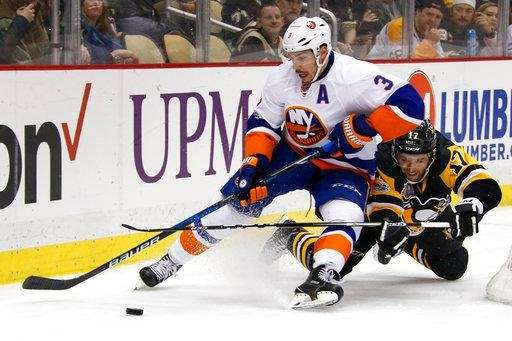 Travis Hamonic collides with Bryan Rust of the