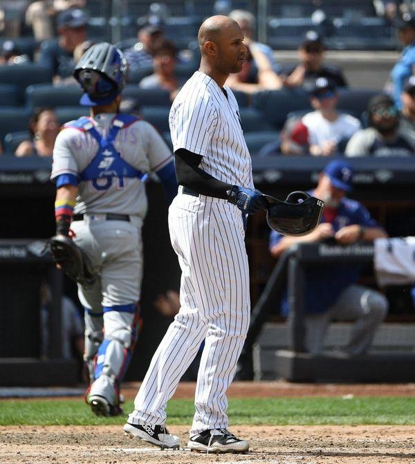Yankees leftfielder Aaron Hicks reacts after he strikes