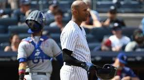 Yankees leftfielder Aaron Hicks reacts after he strikes