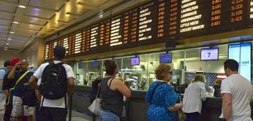 Long Island Rail Road passengers wait to buy
