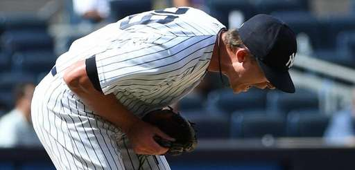 Yankees pitcher Tyler Clippard reacts after he gives