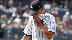 Yankees relief pitcher Tyler Clippard walks to the