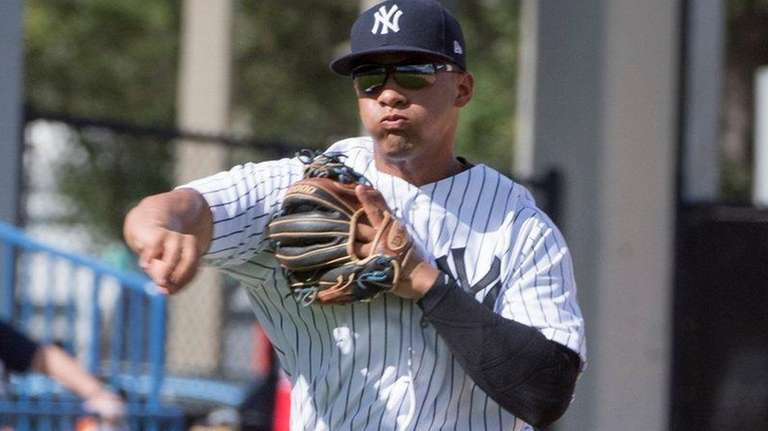 Yankees' Gleyber Torres throws to first against the