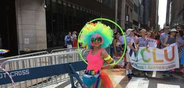 A NYC Pride March participant sports a colorful