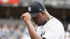 Yankees pitcher Michael Pineda walks to the dugout