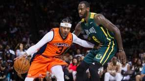 3's Allen Iverson defended by Hogs' Rasual Butler