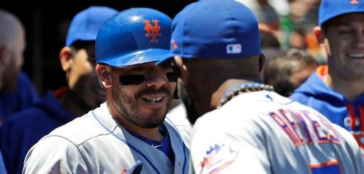 New York Mets' Rene Rivera, left, celebrates his