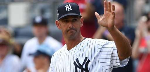 Former Yankees catcher Jorge Posada waves to crowd