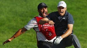 Jordan Spieth celebrates with caddie Michael Greller after
