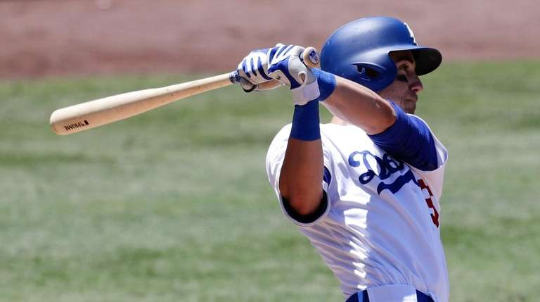 Cody Bellinger watches his two-run home run against
