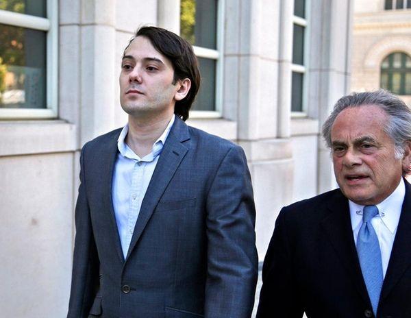 Former Turing Pharmaceuticals CEO Martin Shkreli, left, arrives
