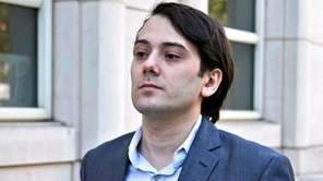 Former Turing Pharmaceuticals CEO Martin Shkreli, left, arrives