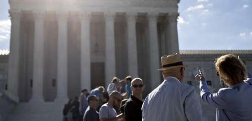 Visitors wait to enter the U.S. Supreme Court