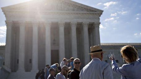 Visitors wait to enter the U.S. Supreme Court