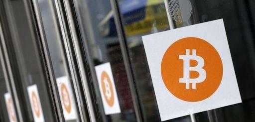 Bitcoin logos are displayed at the Inside Bitcoins