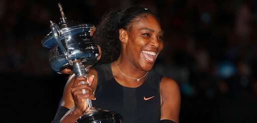 Serena Williams poses with the Daphne Akhurst Trophy