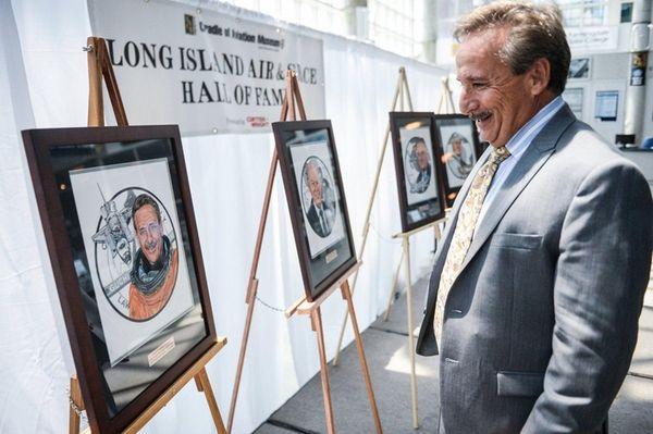Space Shuttle Astronaut Charles Camarda views his painted