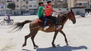 Children ride a horse in the northern city