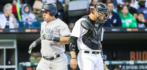 New York Yankees designated hitter Gary Sanchez (L)