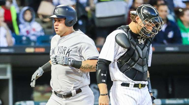New York Yankees designated hitter Gary Sanchez (L)