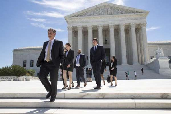 People leave the Supreme Court in Washington, Monday,