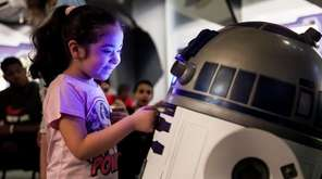 A replica of R2-D2 gets the attention of