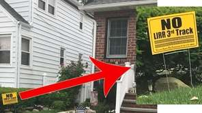 A lawn sign reads